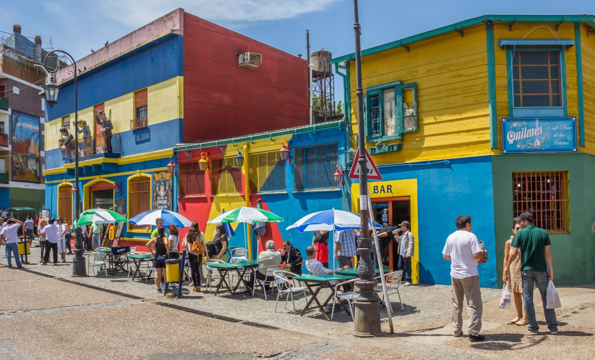 People on the the colorful streets of La Boca neighborhood in Buenos Aires, Argentina